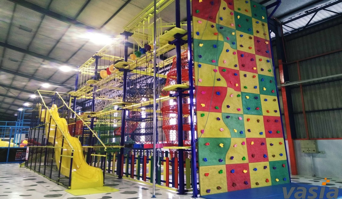 What are the location requirements for gigantic slide in the indoor play place?